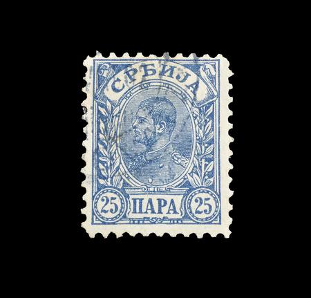 1894年頃、アレクサンダー王の肖像画を示すセルビアによって印刷された郵便切手をキャンセルしました。 報道画像