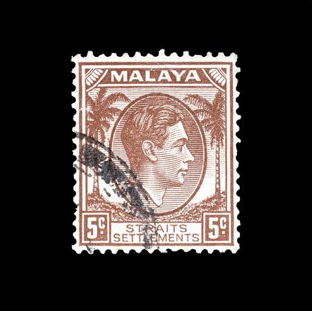 1937年頃、ジョージVI王の肖像画を示すマレーシアで印刷された郵便切手の取り消し。