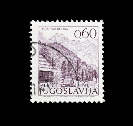 Cancelled postage stamp printed by Yugoslavia, that shows Logarska dolina, circa 1972.