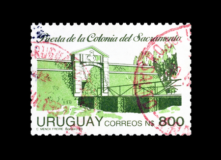 Cancelled postage stamp printed by Uruguay, that shows Entrance of Colonia del Sacramento, circa 1993. Editorial