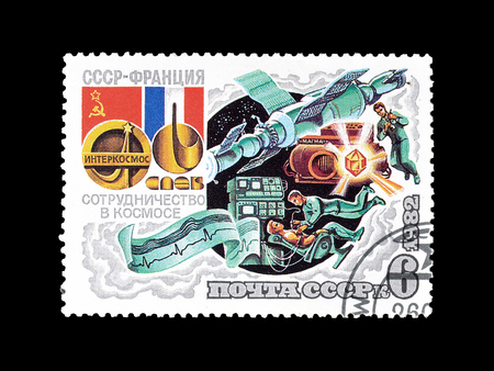 Cancelled postage stamp printed by Soviet Union, that shows The crew of Soyuz T6 on Salyut 6, circa 1982.