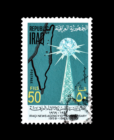 Cancelled postage stamp, printed by Iraq, that shows Radio tower and map of Palestine, circa 1969. 報道画像