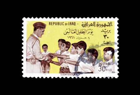 Cancelled postage stamp, printed by Iraq, that shows General Kassem and children, circa 1961.