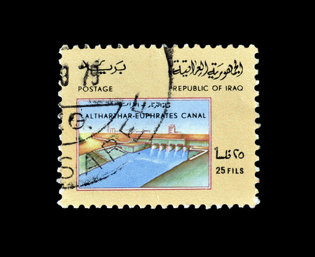 Cancelled postage stamp, printed by Iraq, that shows Altharthar Euphrates canal, circa 1975. 報道画像