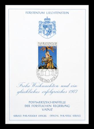 Cancelled block with postage stamp printed by Liechtenstein, that shows figures of wax, circa 1976.