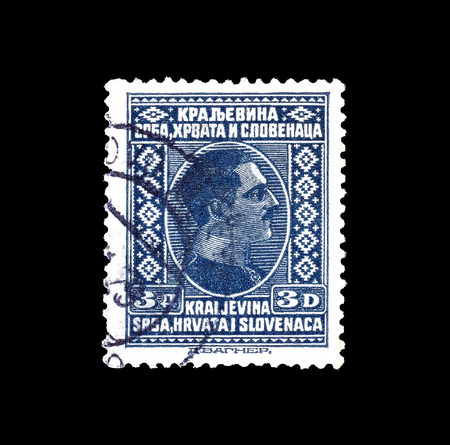Cancelled postage stamp printed by Yugoslavia, that shows portrait of king Alexander, circa 1933.