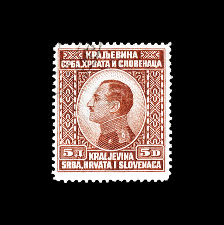 Cancelled postage stamp printed by Yugoslavia, that shows portrait of king Alexander, circa 1924.