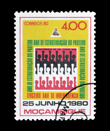 Cancelled postage stamp printed by Mozambique, that shows People with raised hands, circa 1980. 報道画像