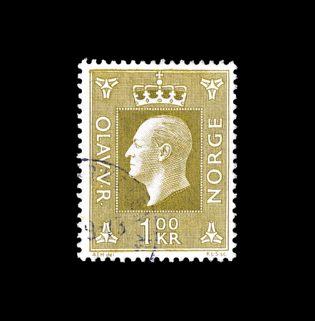 Cancelled postage stamp printed by Norway, that shows portrait of king Olaf, circa 1970.