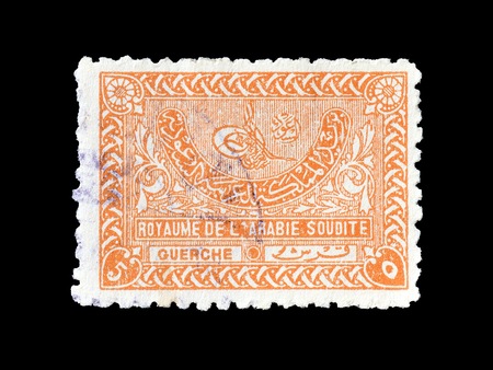 Cancelled postage stamp printed by Saudi Arabia, that shows Tughra of King Abdul Aziz, circa 1934.