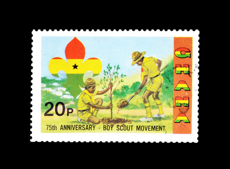 Cancelled postage stamp printed by Ghana, that shows Boy scouts planting a tree, circa 1982. Éditoriale