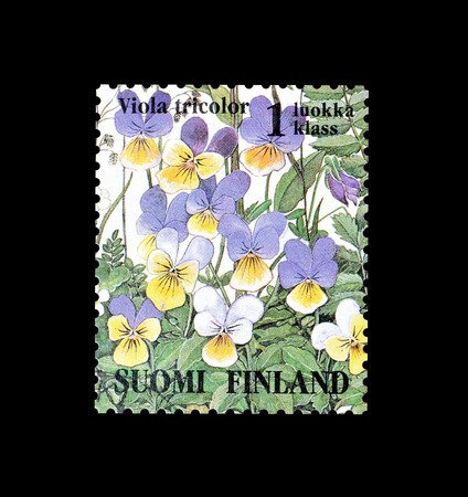 Cancelled postage stamp printed by Finland, that shows Heartsease flower, circa 1994.