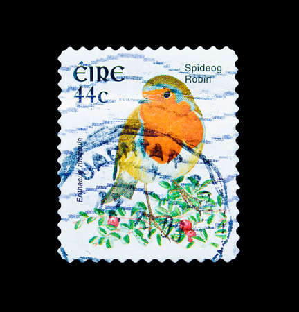 Cancelled postage stamp printed by Ireland, that shows Spideog Robin, circa 2003. 新闻类图片