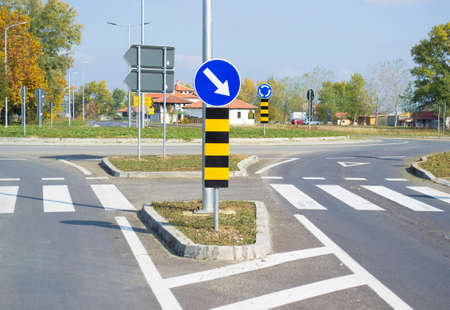 Road sign that shows divers mandatory direction on roundabout