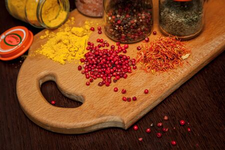 Salt, pepper and spices on the table.