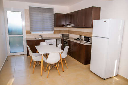 Kitchen with furniture and appliances. Banco de Imagens