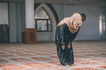 humble: Muslim woman praying in peace Stock Photo