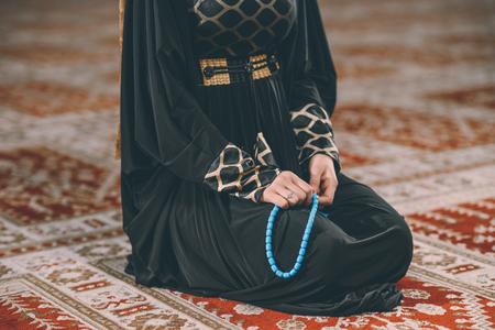 Young Muslim girl praying humbly