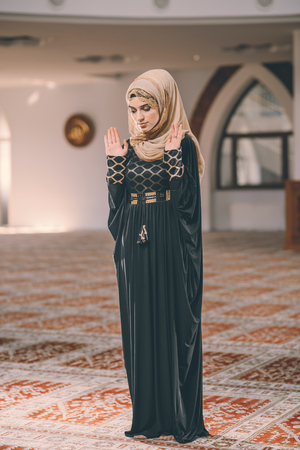 humble: Young Muslim girl praying humbly