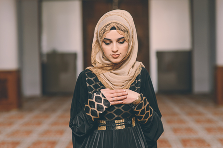 humble: Young Muslim girl praying Stock Photo