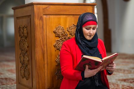 humble: Young Muslim woman praying