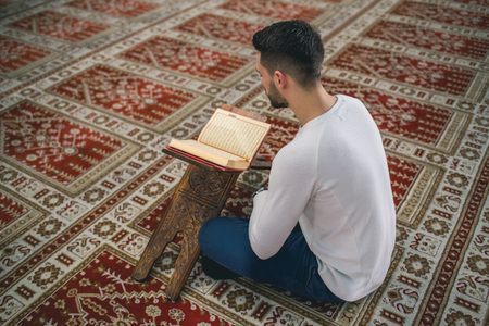 Humble Muslim man reading