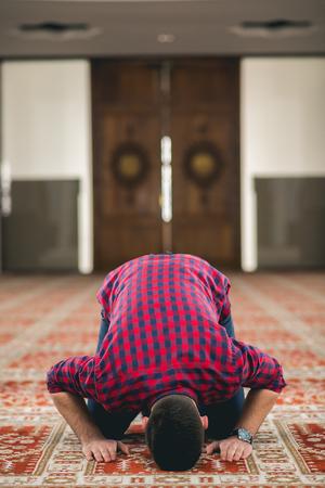 Humble Muslim man praying
