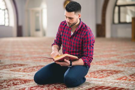 Humble Muslim man reading holy book