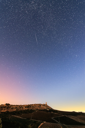 A summer night sky with a meteor over the cefal? diana castle