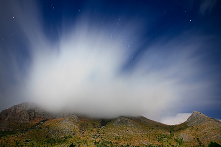 castellammare del golfo: Clouds over Mount Inici - Castellammare del Golfo. The panorama is lit by the moonlight Stock Photo