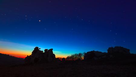 pleiades: Argimusco twilight with Venus and Pleiades Taurus Cassiopeia Stock Photo