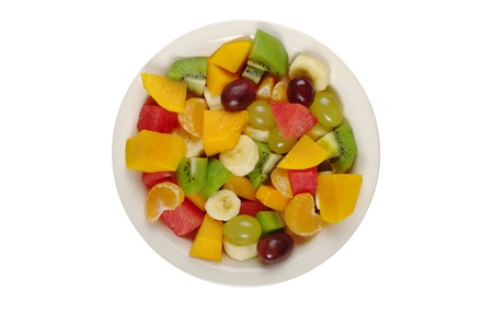 Tropical fruit salad on white plate on white background photographed from above (Isolated)  photo