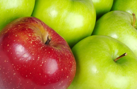 dissimilar: Red colored Apple in between many green Apples (Selective Focus, Close-Up, tilted) Stock Photo