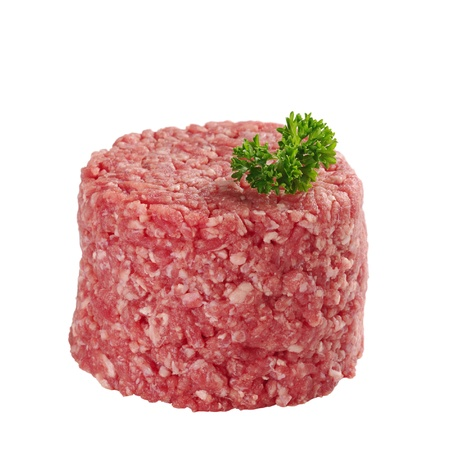 mincing: Ground meat with parsley on top isolated on white (Selective Focus, Focus on front and parsley)
