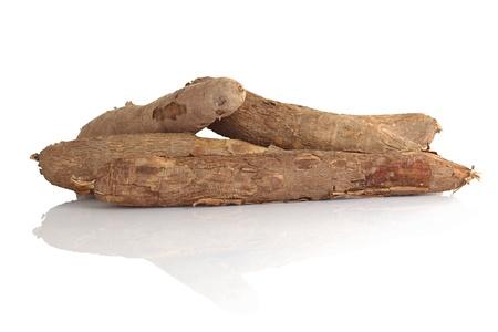 esculenta: Raw cassava (lat. Manihot esculenta) on white (Selective Focus, Focus on the front) Stock Photo