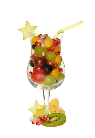 Various fresh exotic fruits in glass symbolizing fruit juice (isolated) photo