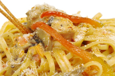 Fettuccine with chicken, mushrooms and red bell pepper (Selective Focus, Focus on Front) photo
