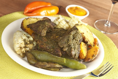 spanish food: Traditional Peruvian food called Pachamanca which is from the Andean region. It consists of different kinds of meat covered with some herbs, broad beans (Spanish: habas), corn, potatoes and sweet potatoes. Traditionally it is cooked in the ground (Selecti Stock Photo