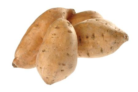 Sweet potatoes (lat. Ipomoea batatas) isolated on white (Selective Focus, Focus on the front sweet potato)  photo