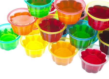 unnatural: Colorful jellies in plastic bowls arranged in a pile and photographed from above