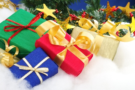 Colorful christmas presents with christmas decoration on cotton (Selective Focus, Focus on the blue and red boxes) Stock Photo - 9193154