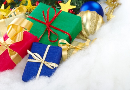 Colorful christmas presents with christmas decoration on cotton (Selective Focus, Focus on the blue box) Stock Photo - 9193151