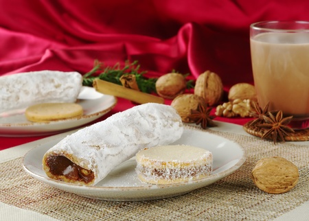 Peruvian cakes filled with a caramel-like cream called Manjar: the long one is called Guarguero, the round one is called Alfajor (Selective Focus, Focus on the front of the two cakes) photo