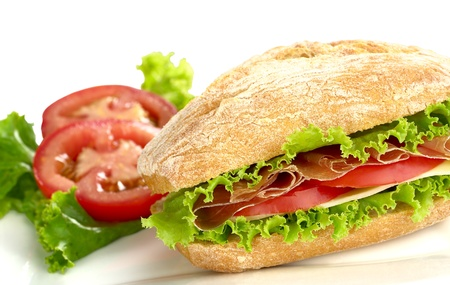 Ciabatta with lettuce, ham, cheese and tomato (Selective Focus, Focus on the front) photo