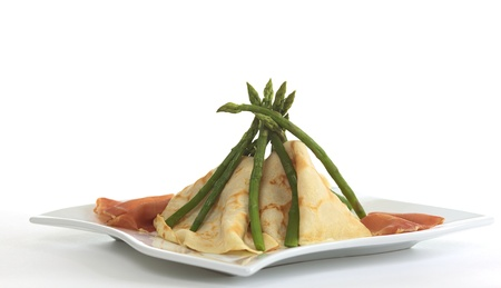 tipi: Crepes and asparagus tipi with ham on the sides (Selective Focus, Focus on the top)
