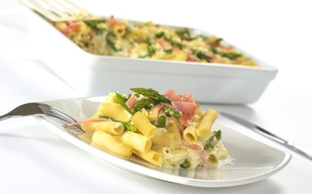 Green asparagus, ham and pasta casserole (Selective Focus, Focus on the front of the food on the plate) photo