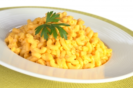 macaroni and cheese: Macaroni and cheese with parsley on top (Selective Focus, Focus on the front of the leaf)