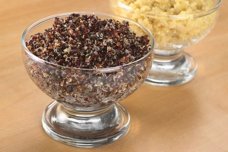 red quinoa: Cooked red and white quinoa in glass bowls which can be eaten as a side dish like rice and is rich in proteins (Selective Focus, Focus on the front of the red quinoa)