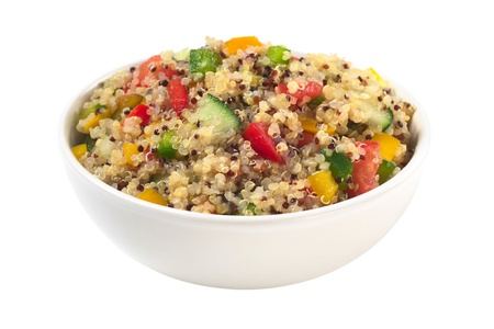 red quinoa: Delicious vegetarian quinoa salad with bell pepper, cucumber and tomatoes isolated on white (Selective Focus, Focus one third into the bowl)  Stock Photo
