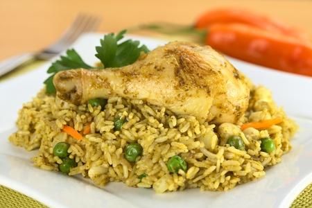 Peruvian dish called Arroz con Pollo (Rice with Chicken), which is made of rice, chicken parts, peas, corn, aji (hot pepper), cilantro